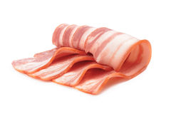 Sliced bacon. Sliced pork bacon on a white background Royalty Free Stock Photo