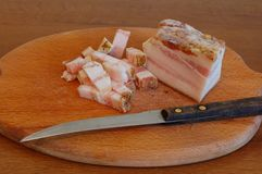 Sliced bacon of salty pork on a chopping board Royalty Free Stock Images