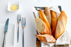 Sliced baguette with butter and knife Royalty Free Stock Photography