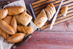 Sliced baguette and rolls on a buffet table Royalty Free Stock Images