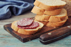 Sliced baguette with salami Royalty Free Stock Photo