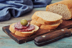 Sliced baguette with salami Stock Image