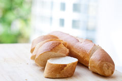 Sliced baguette in a serving board Stock Images