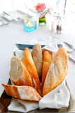Sliced baguette on the table Stock Image