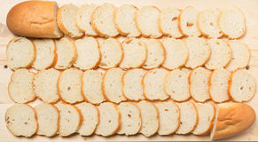 Sliced baguette on the table Stock Images