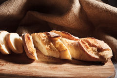 Sliced baguette on wood board. Some tasty sandwiches on wood background. Top view royalty free stock image