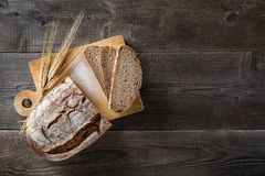 Sliced baked bread on cutting board Royalty Free Stock Images