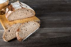 Sliced baked bread on cutting board Royalty Free Stock Photo