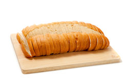 Sliced baked french bread on white Stock Image