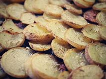 Sliced Baked Potatoes. Spread on baking sheet. Sprinkled with rosemary spice stock photos
