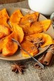 Sliced baked pumpkin sprinkled with cinnamon Stock Photo