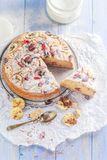 A sliced banana cake with nuts, sesame and cranberry on a wooden stock photo