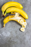 Sliced banana on concrete background. Space for text. Top view Royalty Free Stock Photo