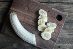 Sliced banana on a cutting board. From above Stock Photography