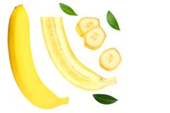 sliced banana with green leaves isolated on white background. Top view royalty free stock photography