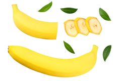 Sliced banana with green leaves isolated on white background. Top view royalty free stock photos