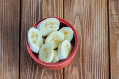 Sliced banana in pot over a table Royalty Free Stock Photos
