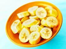 Sliced bananas. Bowl of sliced bananas on table Stock Photography