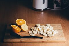Sliced bananas and oranges Royalty Free Stock Photos