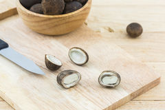 Sliced Barometer Earthstars mushroom on wooden cutting board. Royalty Free Stock Photos