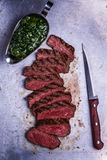 Sliced beef barbecue steak with chimichurri sauce stock photo