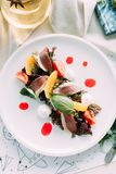 Sliced beef and marbled beef steak with garnish. Restaurant dish for the menu stock photo