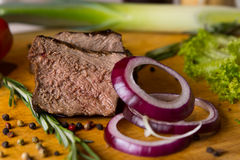 Sliced Beef and Red Onions on Chopping Board. With Other Ingredients Stock Photos