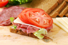 Sliced beef sandwich being prepared Royalty Free Stock Photo
