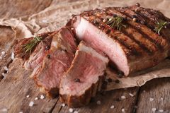 Sliced beef steak medium on an old table. Horizontal close-up Stock Images