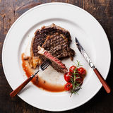 Sliced Beef steak Ribeye with grilled cherry tomatoes Royalty Free Stock Photography