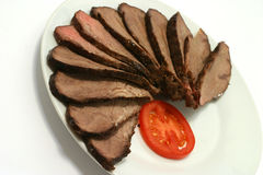 Sliced beef and tomato Stock Photos