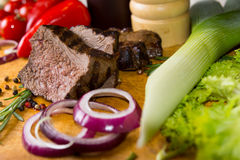 Sliced Beef and Vegetables on Cutting Board Stock Photography
