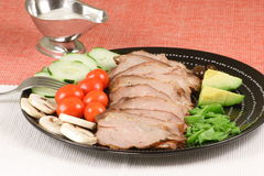 Sliced Beef And Veggies. Perfect roasted beef with fine mushrooms and tomatoes Stock Photo