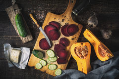 Sliced beet with vegetable on the wooden table top view Stock Photography