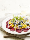 Sliced beetroot served with herring Stock Photos