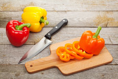 Sliced bell pepper on cutting board. Over wooden table Stock Image