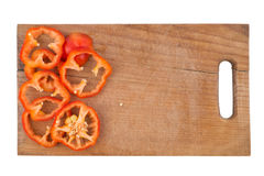 Sliced bell pepper on old cutting board. Isolated on white backg Stock Image