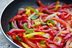 Sliced bell peppers. Fried in a pan Royalty Free Stock Photos