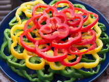 Sliced Bell Peppers on the blue Plate.  stock photo