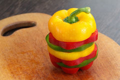 Sliced bell peppers. Dieting concept. Dieting concept. Fresh sliced bell peppers on wooden cutting board royalty free stock photo