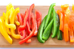 Sliced bell peppers. Sliced red, orange,green and yellow bell peppers ready for stir fry, appetizer, or salad Stock Photos