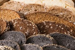 Bakery concept. Plenty of sliced bread background. Sliced black bread gradient background. Bakery and grocery concept. Fresh, healthy whole grain sliced sorts of Royalty Free Stock Photography