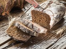 Sliced black bread on the wooden plank. stock image