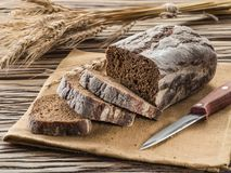 Sliced black bread on the wooden plank. stock photo