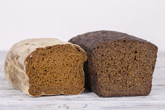 Sliced black bread on white wooden background. Close up Stock Photo