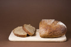 Sliced black bread. On a wooden cutting board Royalty Free Stock Photo