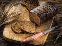 Sliced black bread on the wooden plank. stock photos