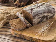 Sliced black bread on the wooden plank. royalty free stock photo