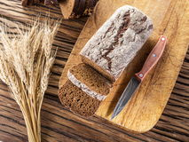 Sliced black bread on a wooden plank. royalty free stock image
