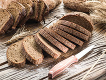 Sliced black bread on the wooden plank. stock images
